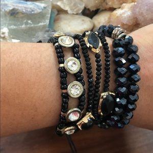 Jewelry - 5 Black And Gold Tone Bracelets